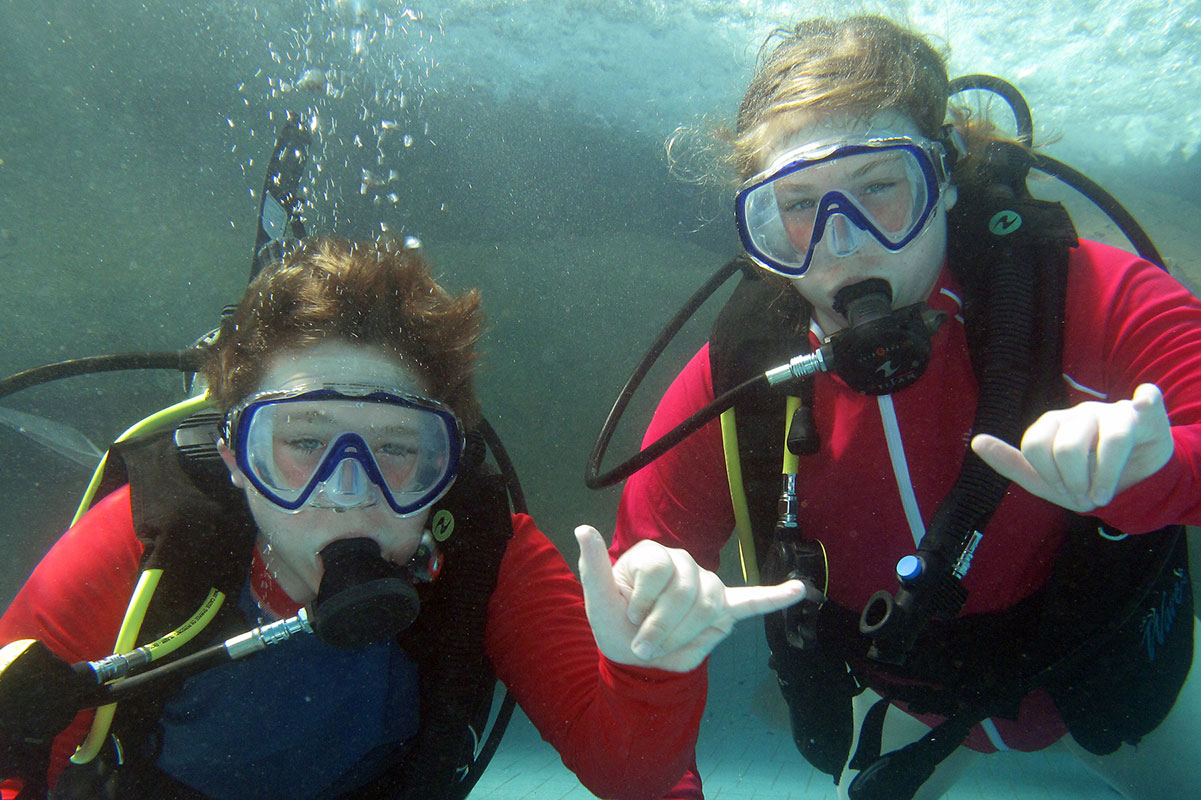 Teenagers love to scuba dive