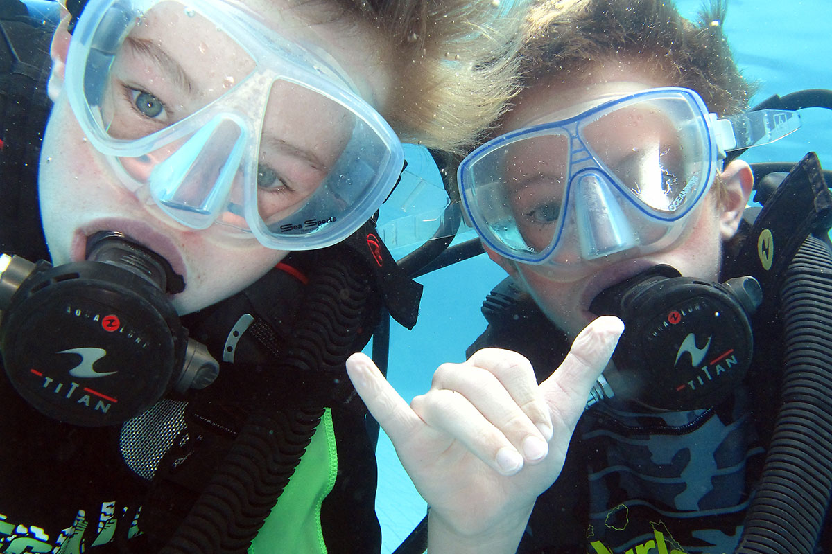 Family scuba diving on Maui